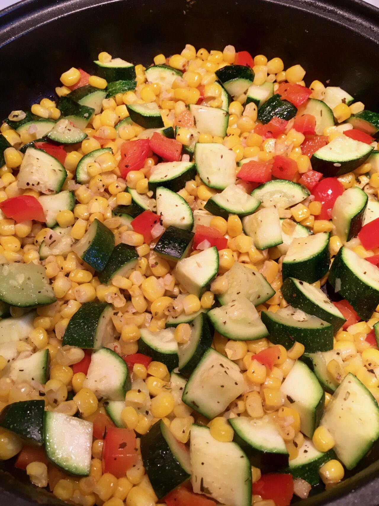 summer vegetables with zucchini, corn, red bell pepper